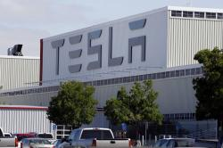 This June 22, 2012, file photo, shows an exterior view of the Tesla factory in Fremont, Calif.