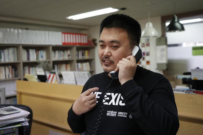 Lee Jong-geol, general director of the gay rights advocacy group Chingusai talks on the phone before an interview in Seoul, South Korea.