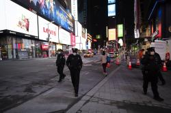 Police officers patrol New York's Times Square on foot, Wednesday night, April 29, 2020, during the coronavirus pandemic.