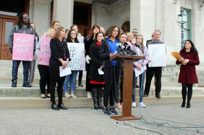 Danbury High School sophomore Alanna Smith speaks during a news conference at the Connecticut State Capitol in Hartford, Conn.