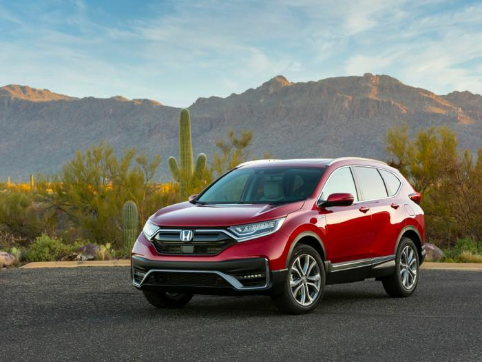 This photo provided by Honda shows the 2020 Honda CR-V Hybrid. The Honda CR-V Hybrid and Toyota RAV4 Hybrid are similar in fuel economy, power and practicality according to Edmunds. Each is a smart buy for a fuel-efficient SUV