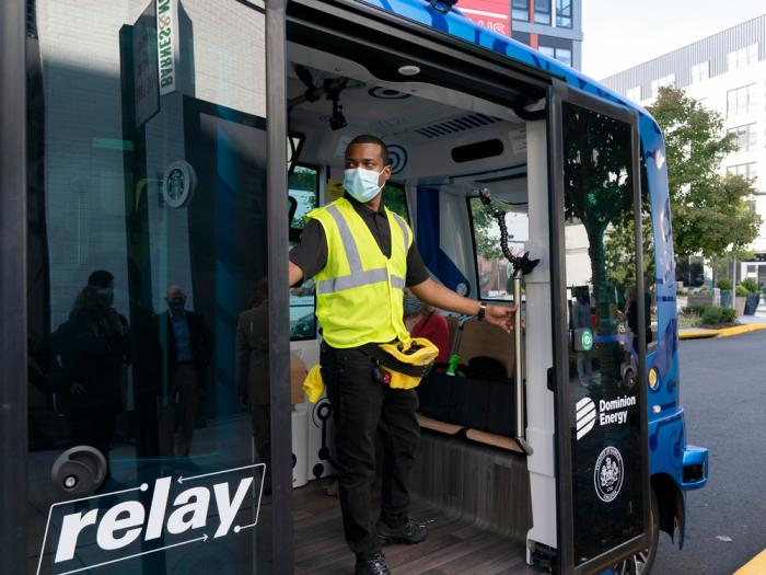 Deployment Manager Jason Peres prepares to close the doors on the Relay, an electric autonomous vehicle, in Fairfax, Va., Thursday, Oct. 22, 2020