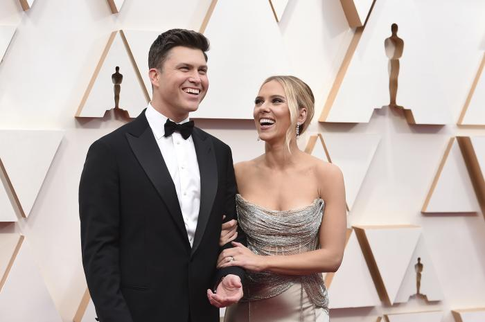 Colin Jost, left, and Scarlett Johansson arrive at the Oscars in Los Angeles.