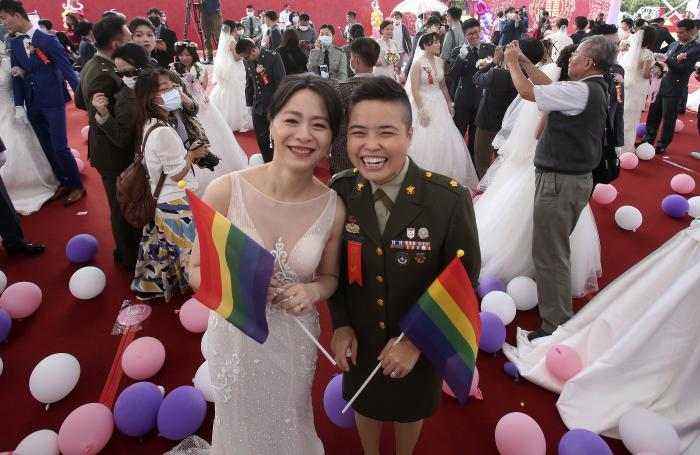Lesbian couple Yi Wang, right, and Yumi Meng pose during a military mass weddings ceremony in Taoyuan city, northern Taiwan.