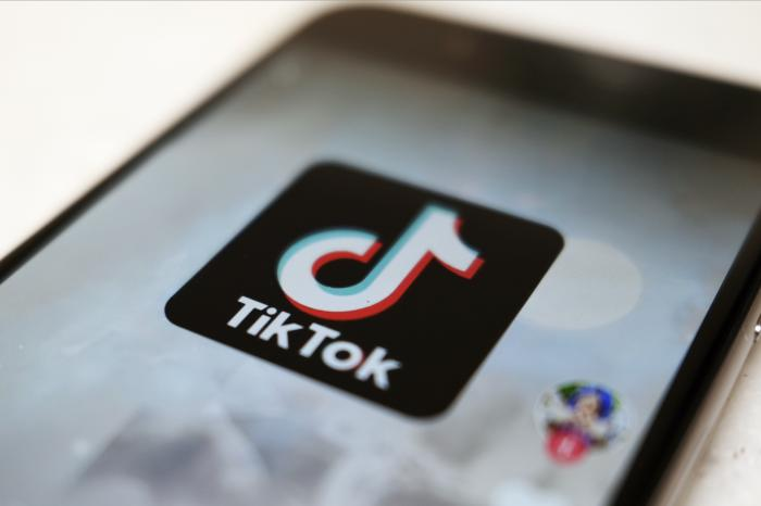 The logo of a smartphone app TikTok on a user post on a smartphone screen in Tokyo.