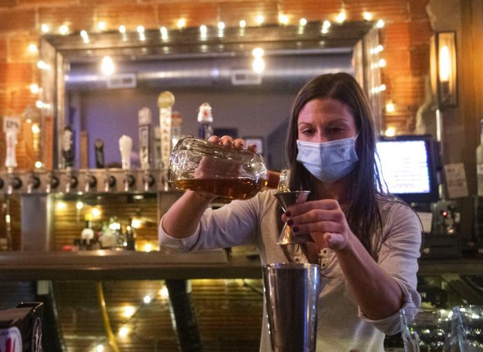 Bartender Kellie Mottiqua prepares drinks, Monday, Nov. 23, 2020, at Bridgetown Taphouse in Ambridge, Penn.