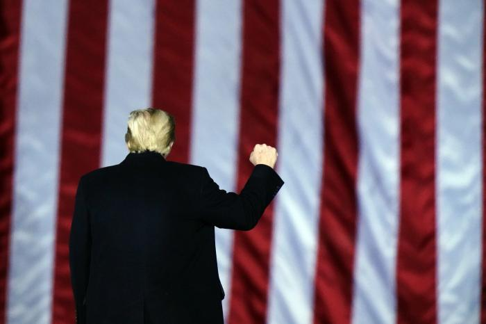 President Donald Trump gestures at a campaign rally in support of U.S. Senate candidates Sen. Kelly Loeffler, R-Ga., and David Perdue in Dalton, Ga., Monday, Jan. 4, 2021. (AP Photo/Brynn Anderson)