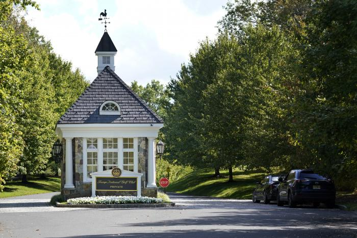 In this Friday, Oct. 2, 2020, file photo, the entrance to Trump National Golf Club is seen in Bedminster, N.J.