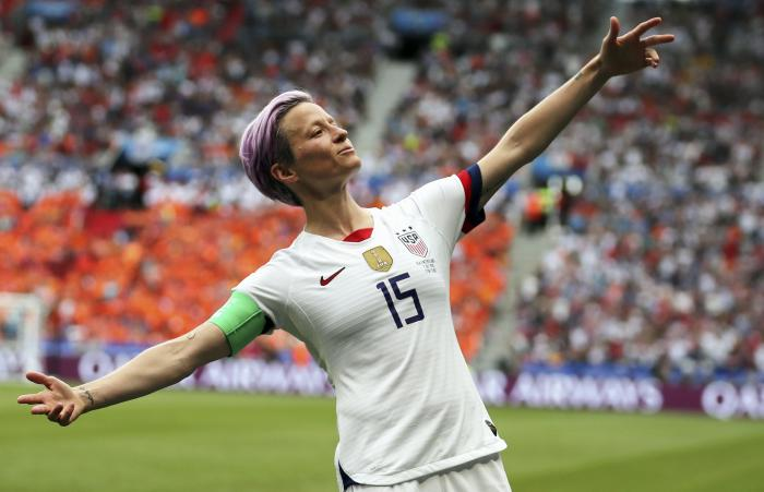 United States' Megan Rapinoe celebrates after scoring the opening goal from the penalty spot during the Women's World Cup final soccer match against The Netherlands at the Stade de Lyon in Decines, outside Lyon, France.