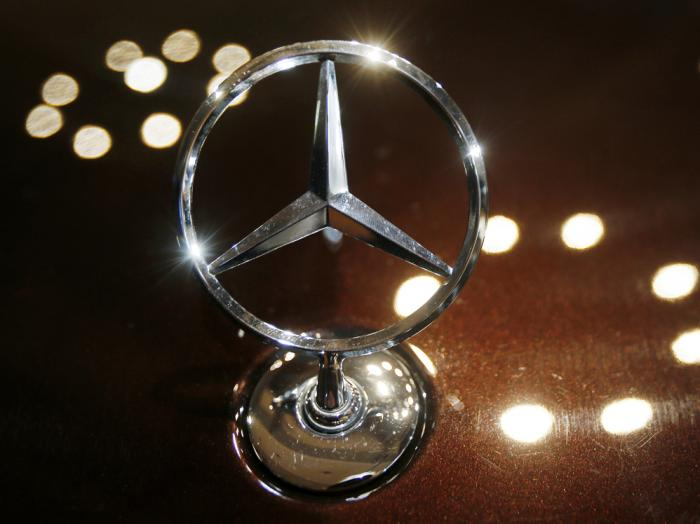 In this Feb. 5, 2015 file photo the logo of a Mercedes car is photographed during an annual press conference of Daimler AG in Stuttgart, Germany